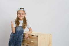 Girl in overalls collector relies on the chest shows class Stock Images
