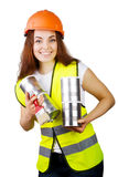 Girl in overalls and a helmet with metal cans and a brush in hands. isolation. stock images
