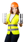 Girl in overalls and a helmet with metal cans in their hands. Isolated. Royalty Free Stock Photos