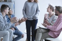 Girl overcoming depression. Talking in front of support group Stock Photography