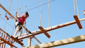 Girl having active leisure in adventure park stock footage