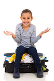 Girl overfilled suitcase Stock Photo
