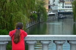 Young Girl Enjoying the Canal. A tourist girl enjoying the serene canal views at a quiet spot Ljubljana, Slovenia Stock Images