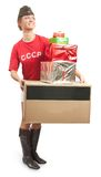 Girl in overseas cap with coloured shopping bags Royalty Free Stock Image