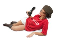 Girl in overseas cap holding gun. Royalty Free Stock Image