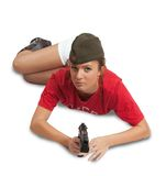 Girl in overseas cap holding gun Royalty Free Stock Photos
