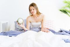 Girl is overslept. A girl is overslept, she missed the alarm Royalty Free Stock Photos