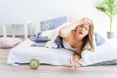 Girl is overslept. A girl is overslept, she missed the alarm Royalty Free Stock Photo