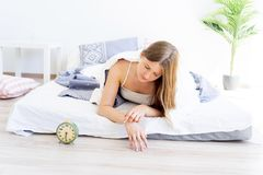 Girl is overslept. A girl is overslept, she missed the alarm Stock Photos