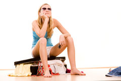 Girl on overstuffed suitcase Stock Photos