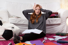 Girl overwhelmed by schoolwork Royalty Free Stock Photos