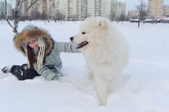 Girl owner hugging white Samoyed dog Royalty Free Stock Photography