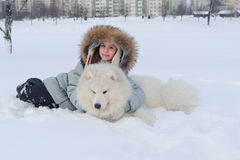 Girl owner hugging white Samoyed dog Stock Photos