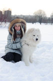 Girl owner hugging white Samoyed dog Stock Photography