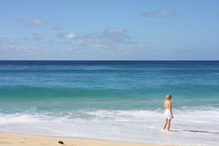 Girl and pacific ocean Royalty Free Stock Photos