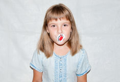 Girl with a pacifier Royalty Free Stock Photography