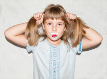 Girl with a pacifier Royalty Free Stock Image