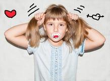 Girl with a pacifier Stock Photos