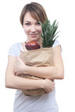 Girl with package of fruits and green apple Royalty Free Stock Photo