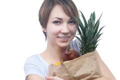 Girl with package of fruits and green apple Stock Photography