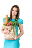 Girl with a package from the grocery store Stock Image
