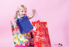 Girl with packages Royalty Free Stock Image