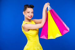 Girl with packages Stock Images
