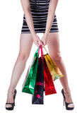 The girl with packages in a short dress. Isolated white background Stock Photography