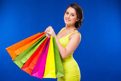 Girl with packages Stock Photography