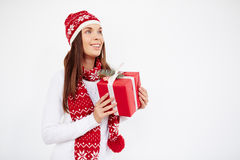 Girl with packed gift Royalty Free Stock Images
