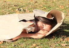 Girl packed in paper Royalty Free Stock Photos