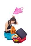 Girl packing Royalty Free Stock Image