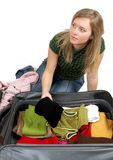 Girl is packing clothes. On bag Royalty Free Stock Images