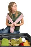 Girl is packing clothes. Separate on white Stock Photography