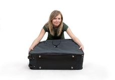 Girl is packing clothes. Separate on white Royalty Free Stock Image