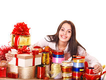 Girl packing group of gift box. Stock Images