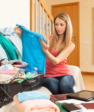 Girl packing luggage Stock Photo