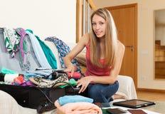 Girl packing luggage Royalty Free Stock Image