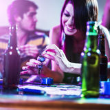 Girl packing a pipe with marijuana Stock Image