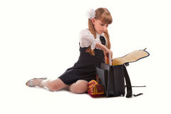 Girl packing school bag Stock Photography