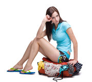 Girl packing suitcase Royalty Free Stock Photo