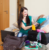 Girl packing suitcase for holiday Royalty Free Stock Photos