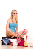 Girl packing summer clothes Royalty Free Stock Photos