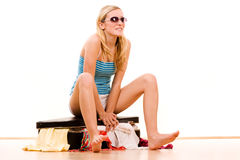 Girl packing summer clothes Stock Image