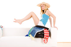 Girl packing for summer trip Royalty Free Stock Images