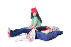 Girl packing for travel Royalty Free Stock Images