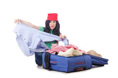 Girl packing for travel Royalty Free Stock Photos