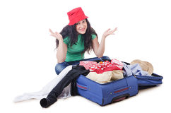 Girl packing for travel Royalty Free Stock Image