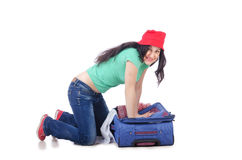 Girl packing for travel vacation Royalty Free Stock Images