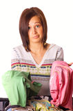 Girl packs her clothes. In suitcase Stock Photo